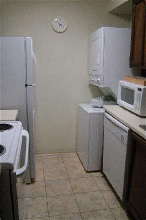 the kitchen with full size fridge, dishwasher, rangetop