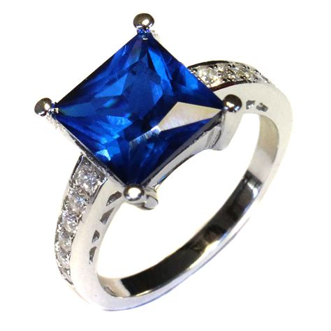 Princess Cut Sapphire Promise Ring  Blue Cubic Zirconia. Inset Wedding Rings. Heartbeat Engagement Rings. Father Rings. Modern Vintage Wedding Rings. Fantastic Engagement Rings. Shoulder Rings. Hammered Finish Wedding Rings. Rate Wedding Rings