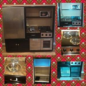 Old entertainment center turned into play kitchen. My ...