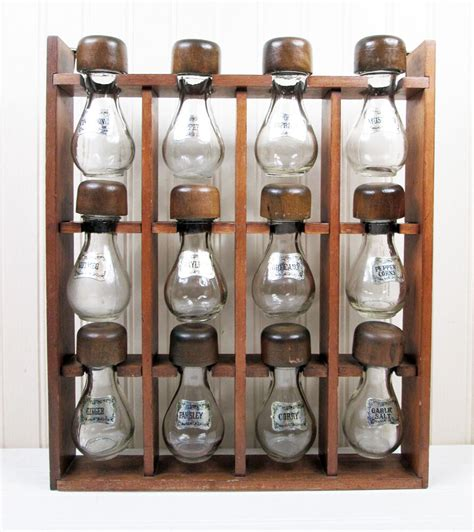 Wooden Hanging Spice Rack by Vintage Wood Hanging Spice Rack 12 Glass Plastic Shaker