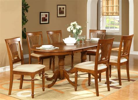 pc oval dining set table    chairs  saddle