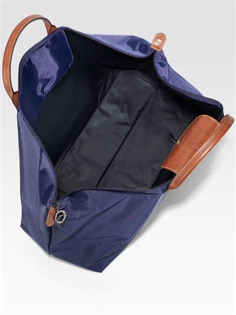longchamp le pliage travel bag  blue lyst
