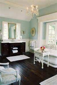 master bathroom the floor with the light blue green walls and white trim bathrooms