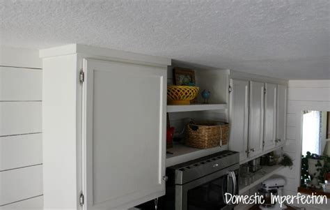 how to add moulding to kitchen cabinets how to raise your kitchen cabinets to the ceiling 9284