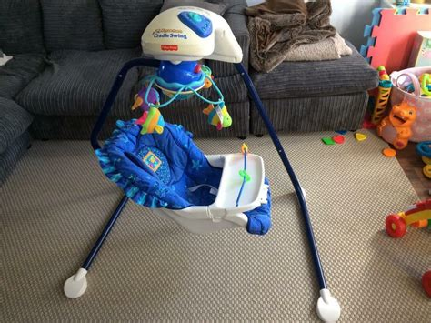 Fisher Price Wonders Cradle Swing by Fisher Price Wonders Aquarium Cradle Swing Still