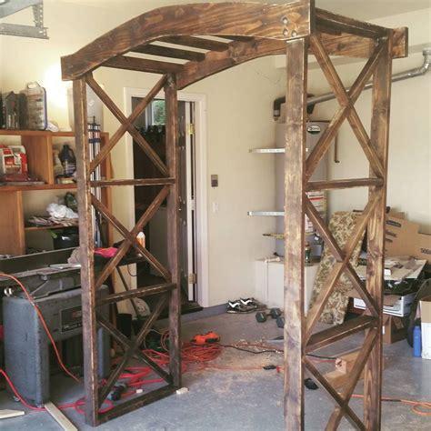 rob  dad build  wooden arch     wedding