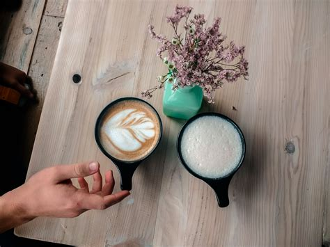 All across the city, these coffee shops are oases, filled with entrepreneurs, musicians, students, and more. Slowhand Coffee + Bakeshop - Nashville, TN #flower #plant #teal #coffee #latte #specialtylatte # ...