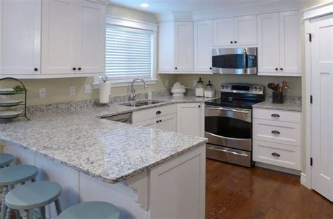kitchen remodel ashen white granite countertop and white