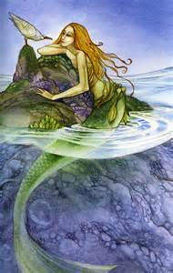Beautiful Mermaids Swimming