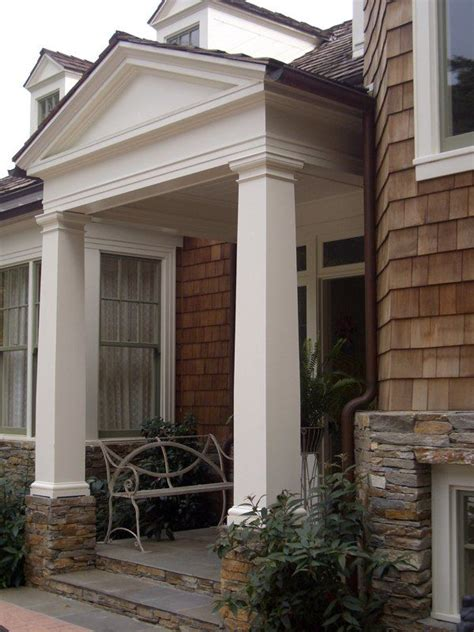 covered porch columns shake shingles stone outdoor entryway farmhouse remodel