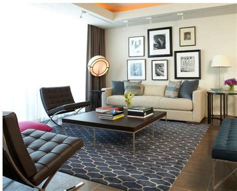 Brown Barcelona Chairs With Blue Rug