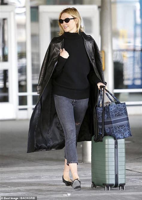 Karlie Kloss Beams She Returns From Paris Fashion Week