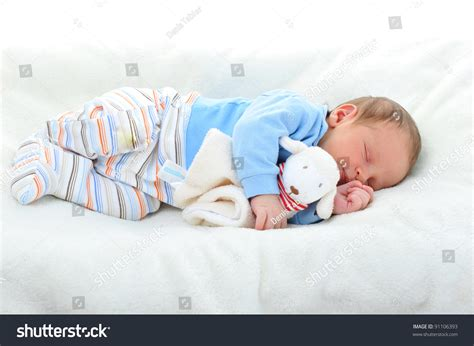 Cute Baby With Toy Sleeping On White Blanket Stock Photo 91106393 Open Heart Crochet Blanket Pattern Kate Spade Queen Fleece Sunbeam Microplush Heated Review Dog Bed Or Simple Uk Term For Pigs In A How To Make Knitted Wider Baby