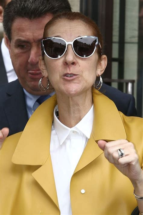 celine dion goes chic and cheery in yellow coat after