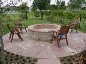 backyard landscaping ideas with concrete firepit on
