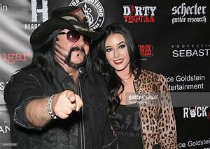 Drummer Vinnie Paul (L) of Hellyeah and Chelsey Yeager ...