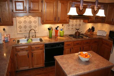 Non Granite Countertops - oak kitchen cabinets with countertop and back splash