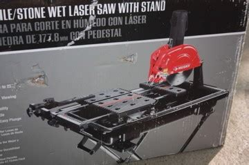 husky 7 inch wet tile saw with laser and stand new in