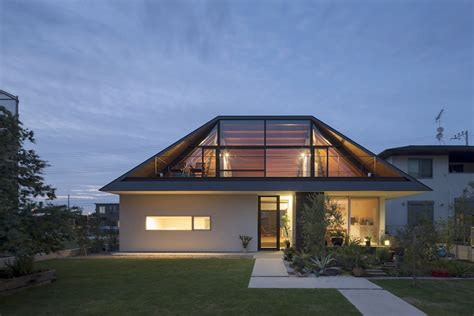 house with a large hipped roof naoi architecture design office archdaily