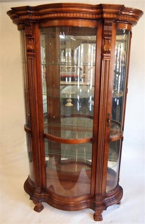 curved glass curio cabinet 301 moved permanently