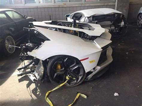 crashed white lamborghini lamborghini aventador in half waiting inside a