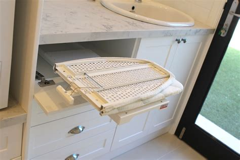 Iron Board Cupboard by Pull Out Ironing Board Folds Out And Rotates 180 Degrees