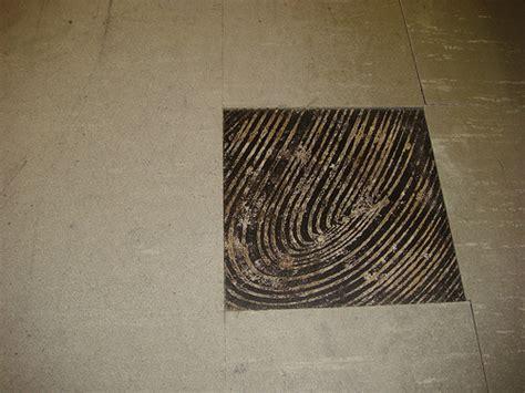 asbestos floor tile black mastic wear damage exle o flickr photo
