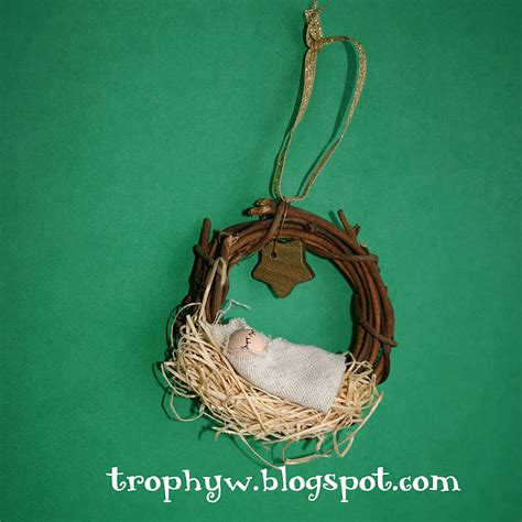tales of a trophy wife away in a manger ornament