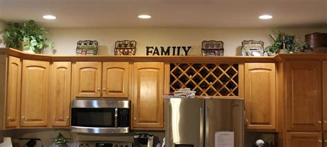 what to put on top of your kitchen cabinets decorating above the kitchen cabinets i put suitcases in