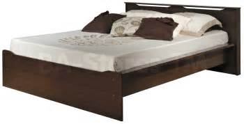bedroom double size platform bed with tufted vinyl headboard and curved with profile platform