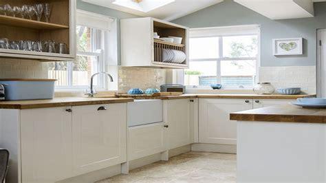 utility room storage units pale blue  cream kitchen