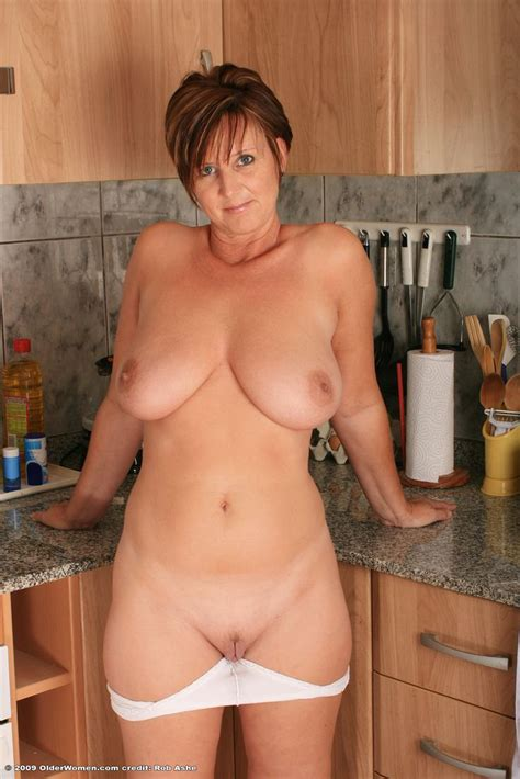 Nearly Nude Woman Showing Her Mature Pussy