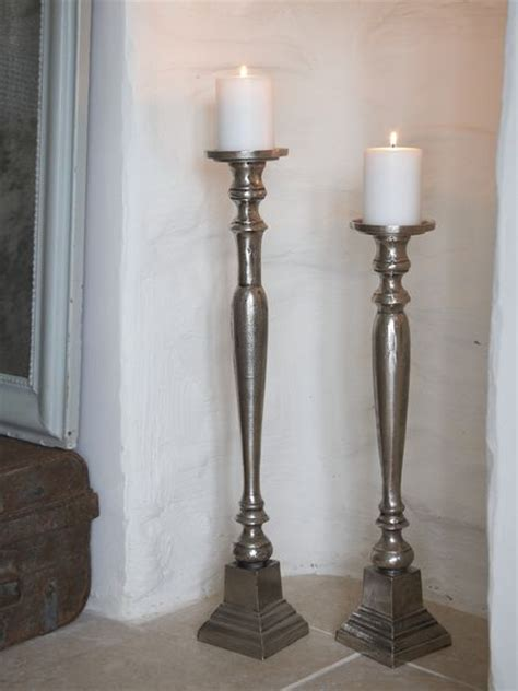 aged metal floor candle holders