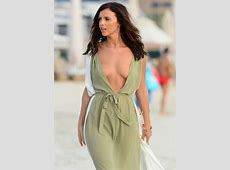 Lucy Mecklenburgh risks nip slip in plunging beach dress
