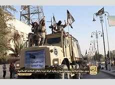 ISIS parades captured Iraqi Army vehicles in its Syrian