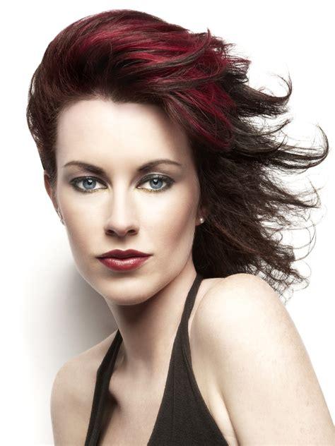 elegant  windswept haircut  dark cherry red hair