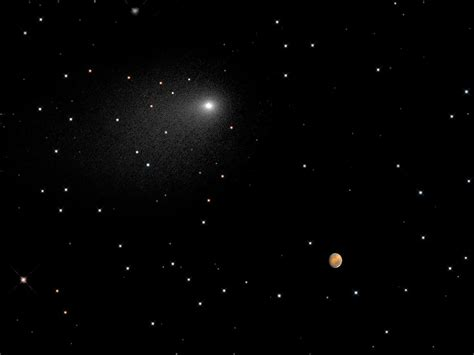 Hubble Views Comet Siding Spring Passing Mars
