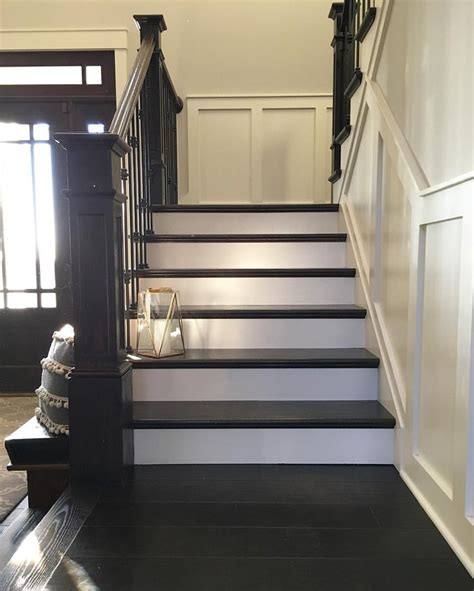 modern farmhouse painted  stained stairs  brass lantern farmhouse redefined