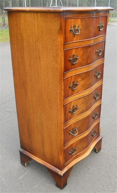 tall narrow yew wood chest  drawers