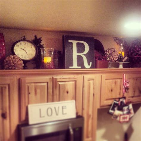 kitchen decorating ideas with accents above cabinet kitchen decor crafty mally decorating