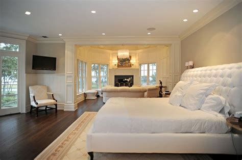 beautiful bedroom with sitting area beyond rooms bed