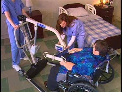 transferring a patient from wheelchair to bed with a
