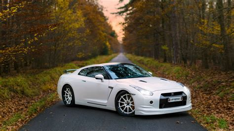White Nissan Gt-r On The Road In The Woods Wallpapers And