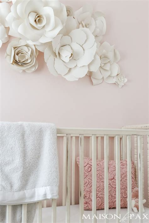 If you are attempting to minimize any wall damage they are a good alternative to the mounting tape. Paper Flower Wall Art in the Nursery - Maison de Pax