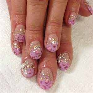 Leopard hand paint nail art with pearls and swarovski nails