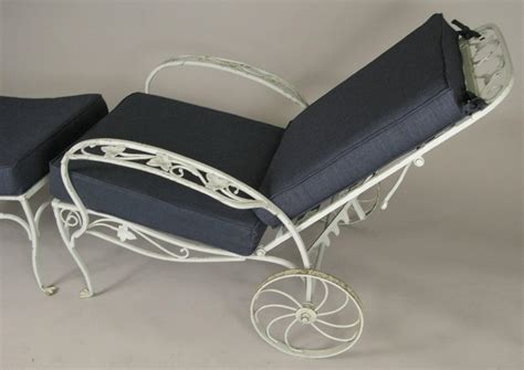 pair of vintage wrought iron adjustable lounge chairs and