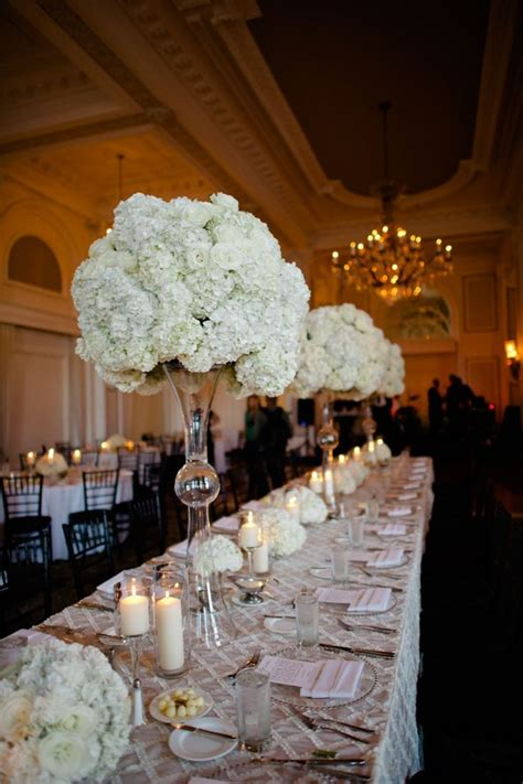 Bridal Party Seating At Estate Table With Tall Vases Of