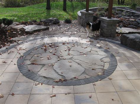 flagstone flower pattern set into concrete paver patio yelp