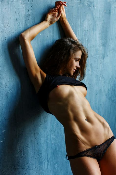 Sexy Brunette With Abs Triplered