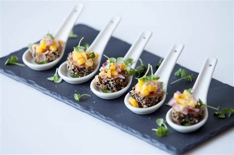 dessert canapes seared sesame tuna on cucumber topped with mango and